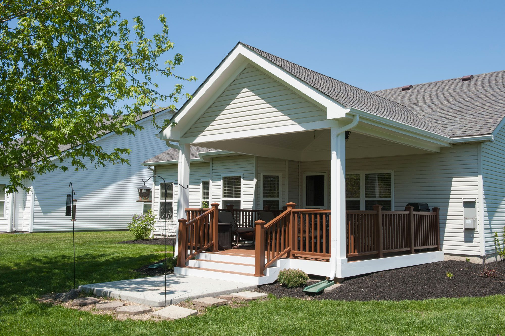 Covered Porch Addition Extends The Indoors Outdoors