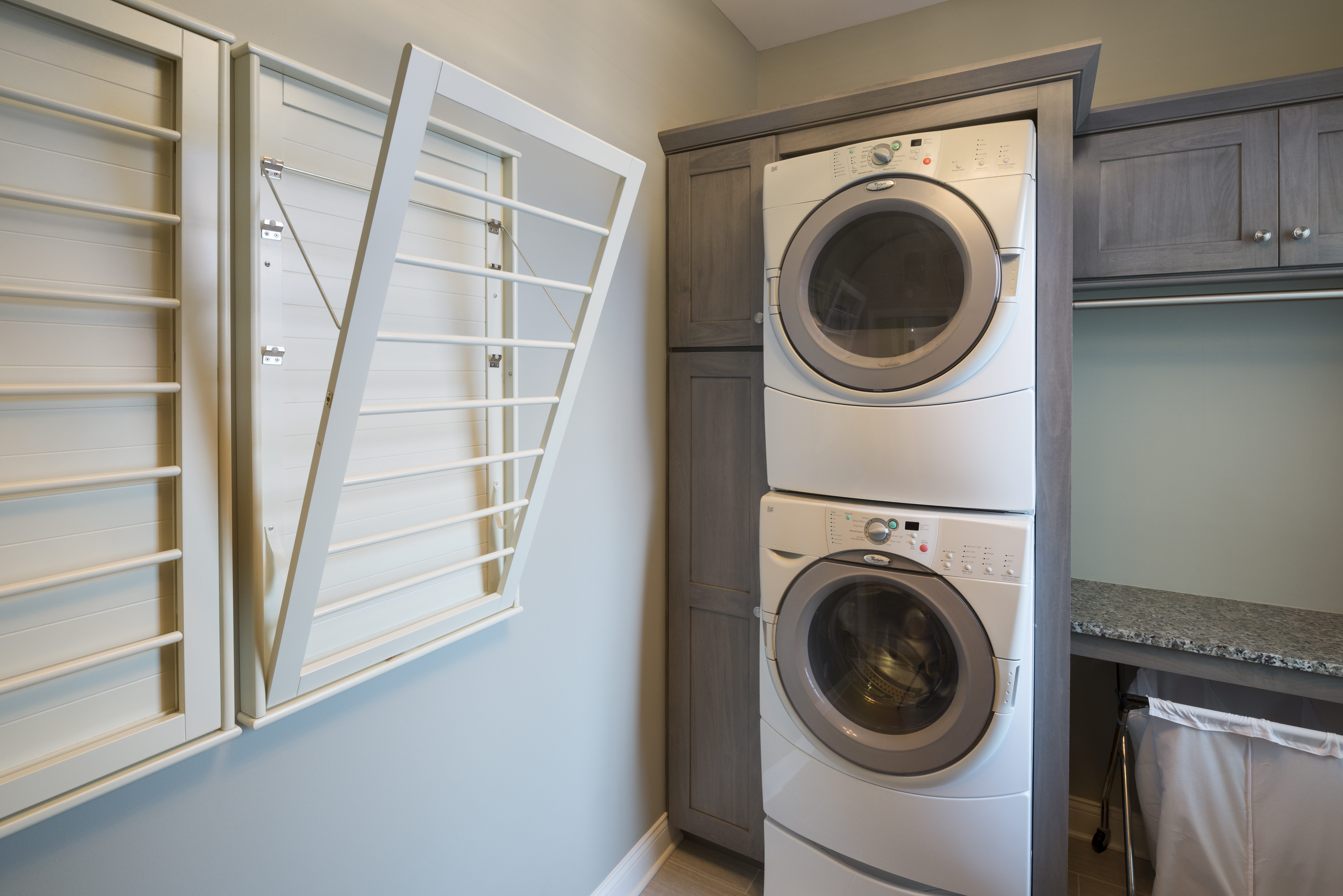 The homeowners a wanted a fold-down, wall-mounted laundry drying rack. What  a great way to maximize this space!